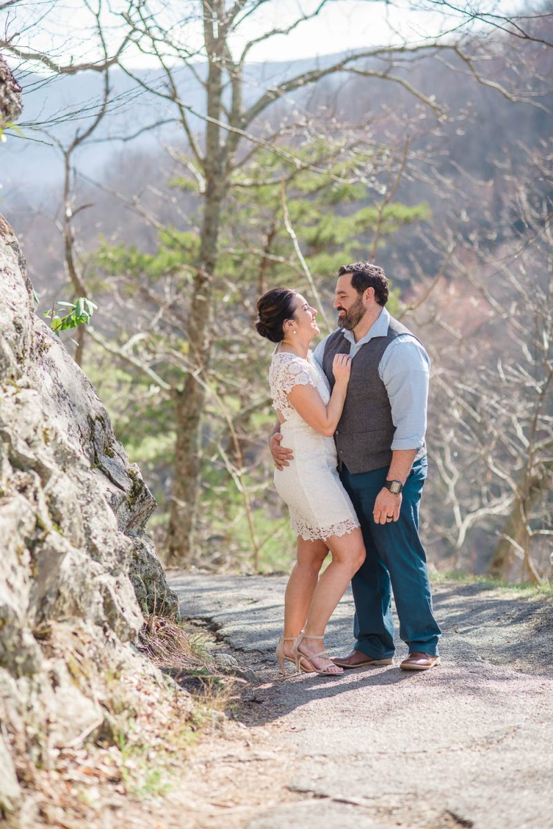 wedding couple standing on edge of laurel falls trail near Elkmont campground