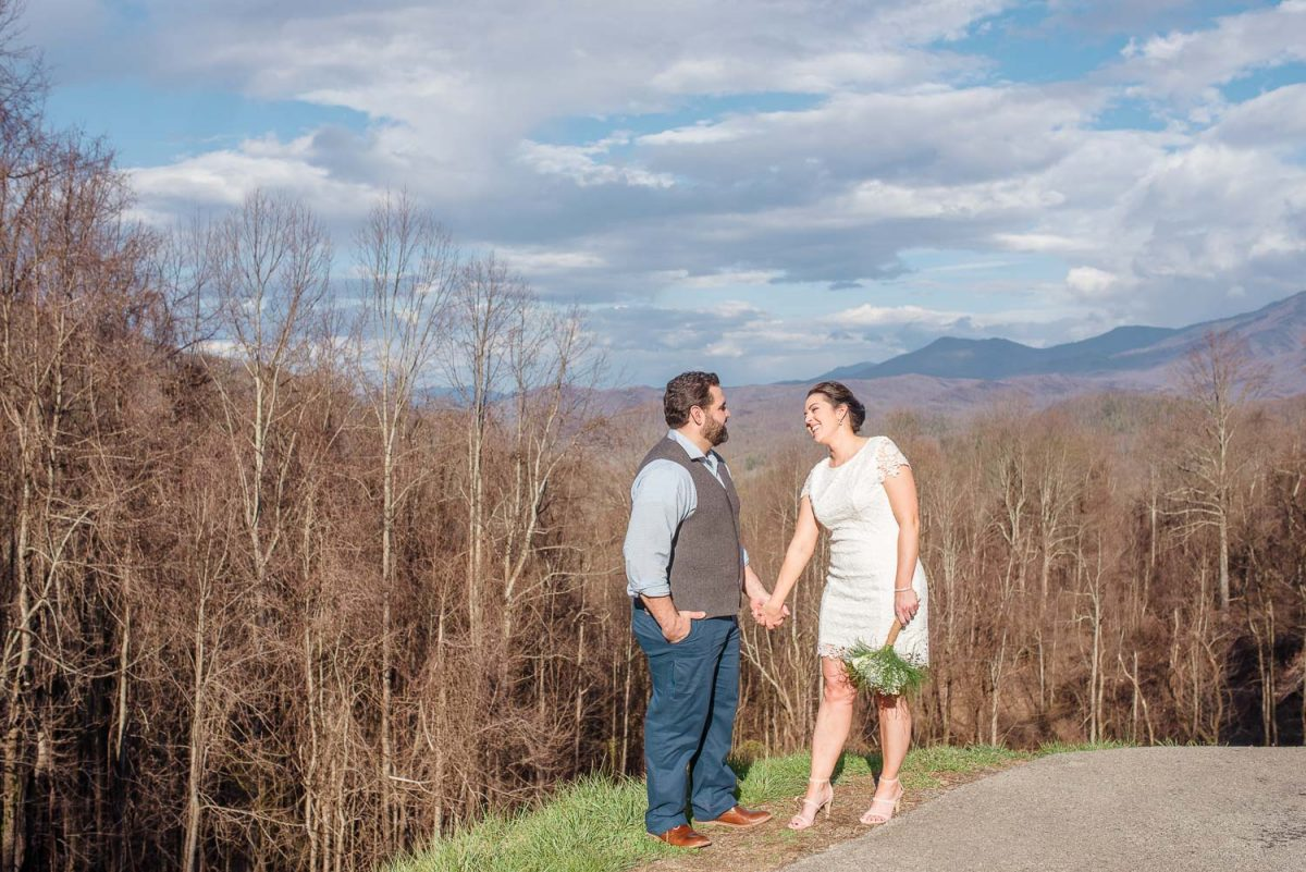 bride and groom holding hands at Overlook in the Smoky mountains