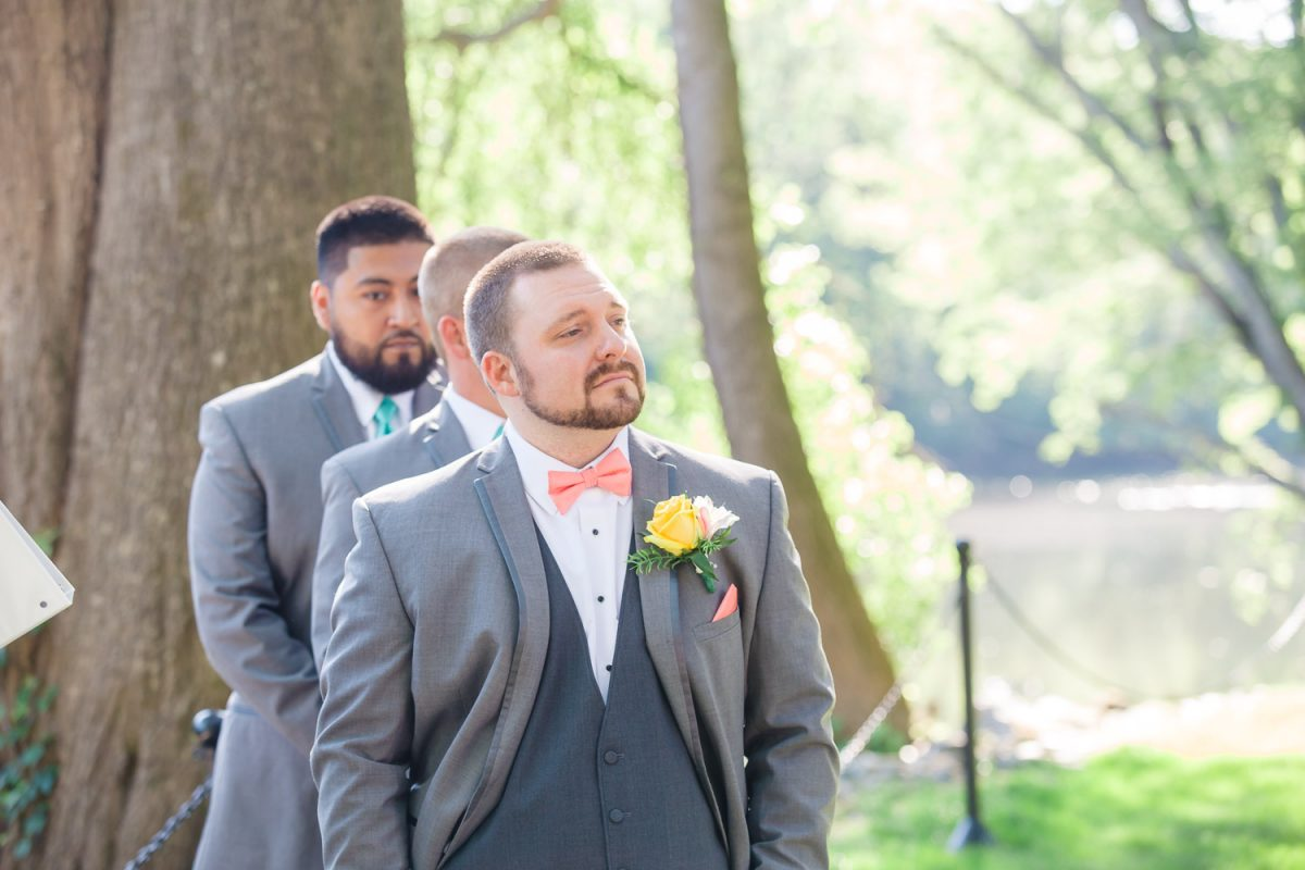 groom watching his bride walk down the aisle at Hiwassee River Weddings