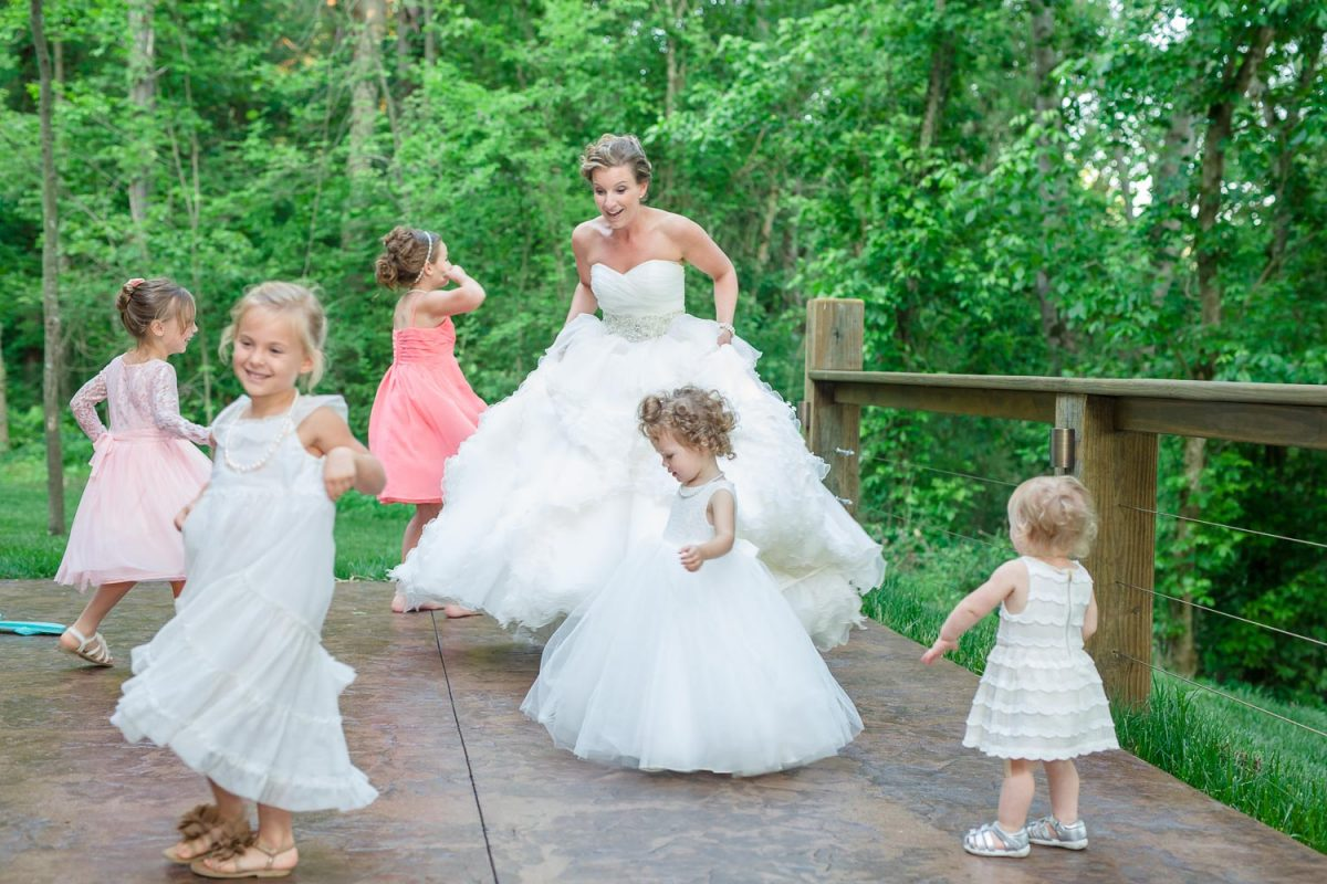 bridedancing with little flower girls on outside patio
