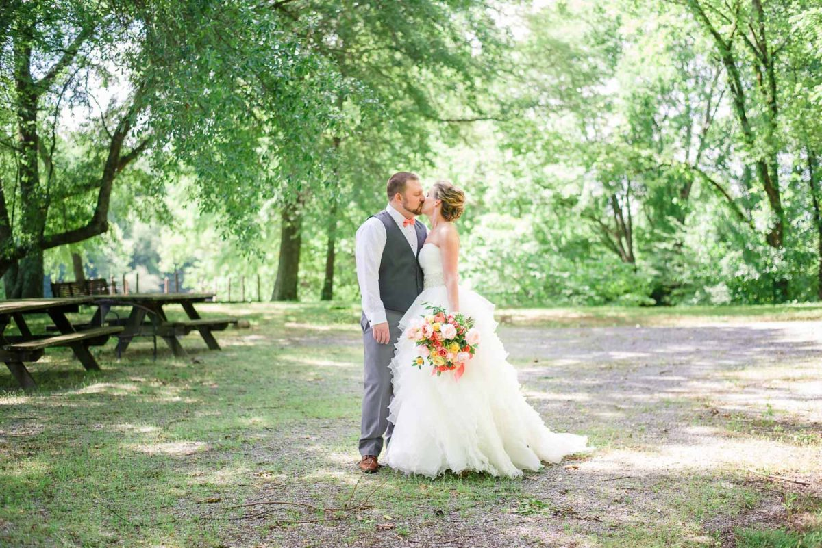 bride and groom sharing a kiss at first look at Hiwassee River weddings in TN