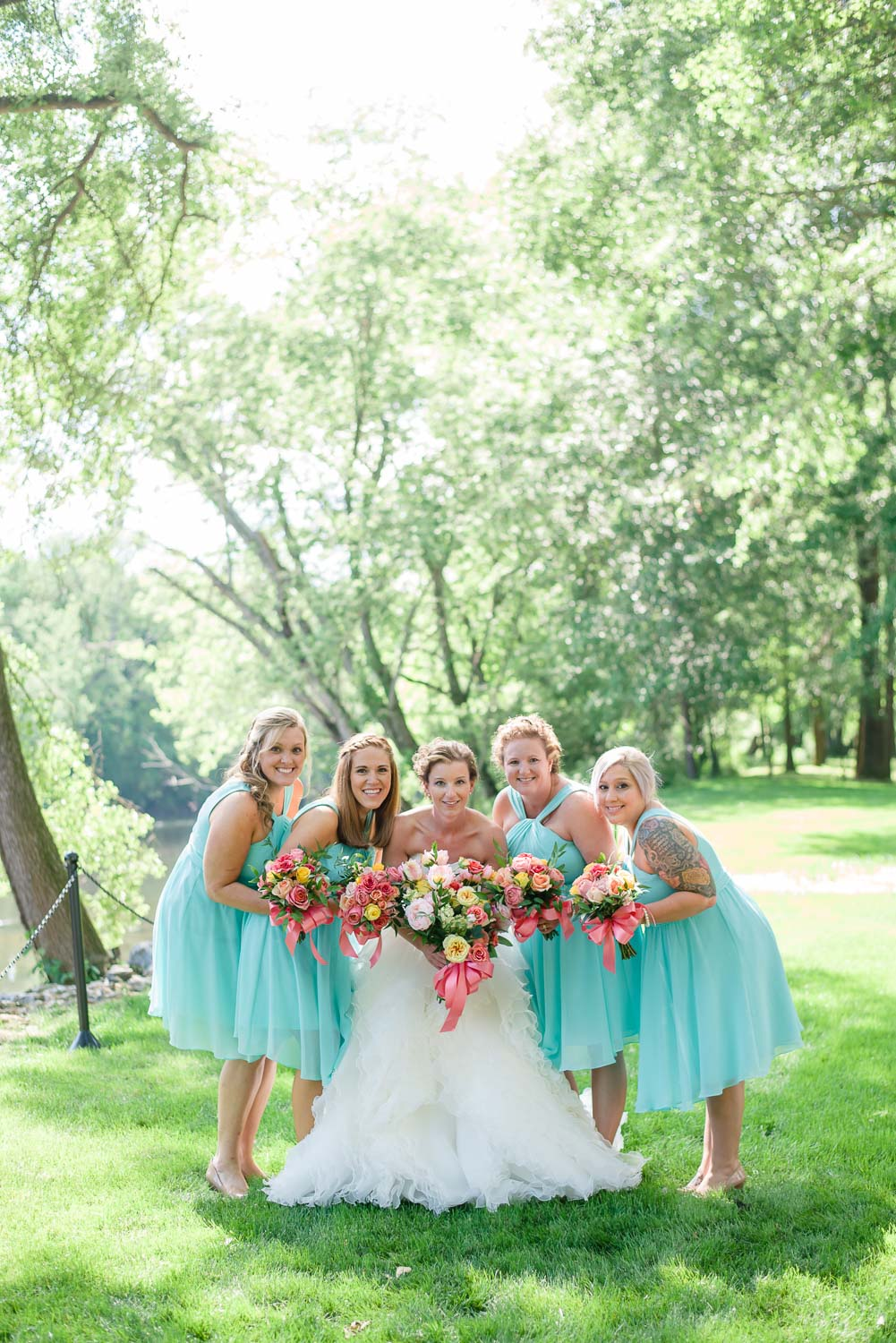 bridesmaids in aqua short dress with coral flowers