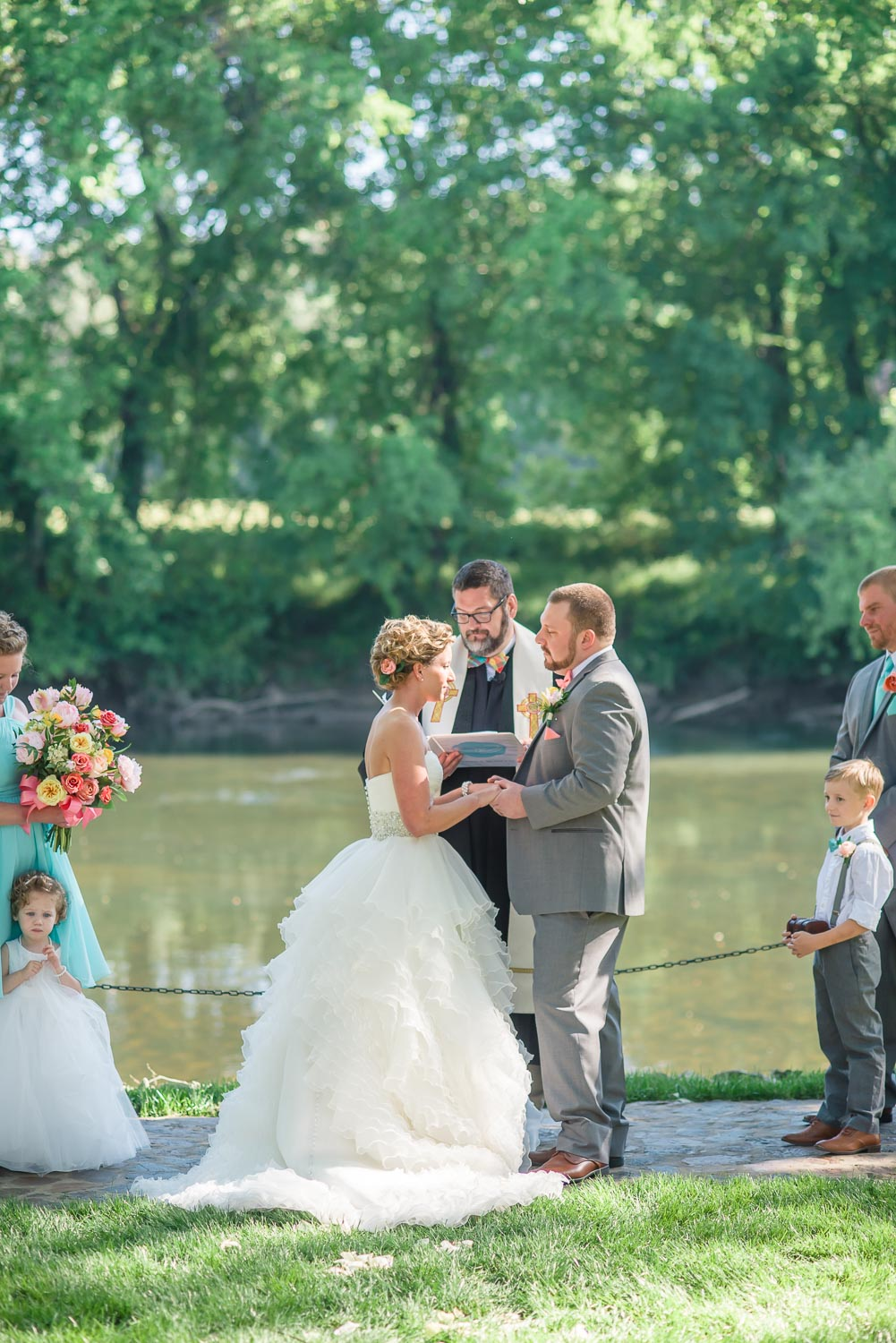 couple getting married on the edge of the river in TN