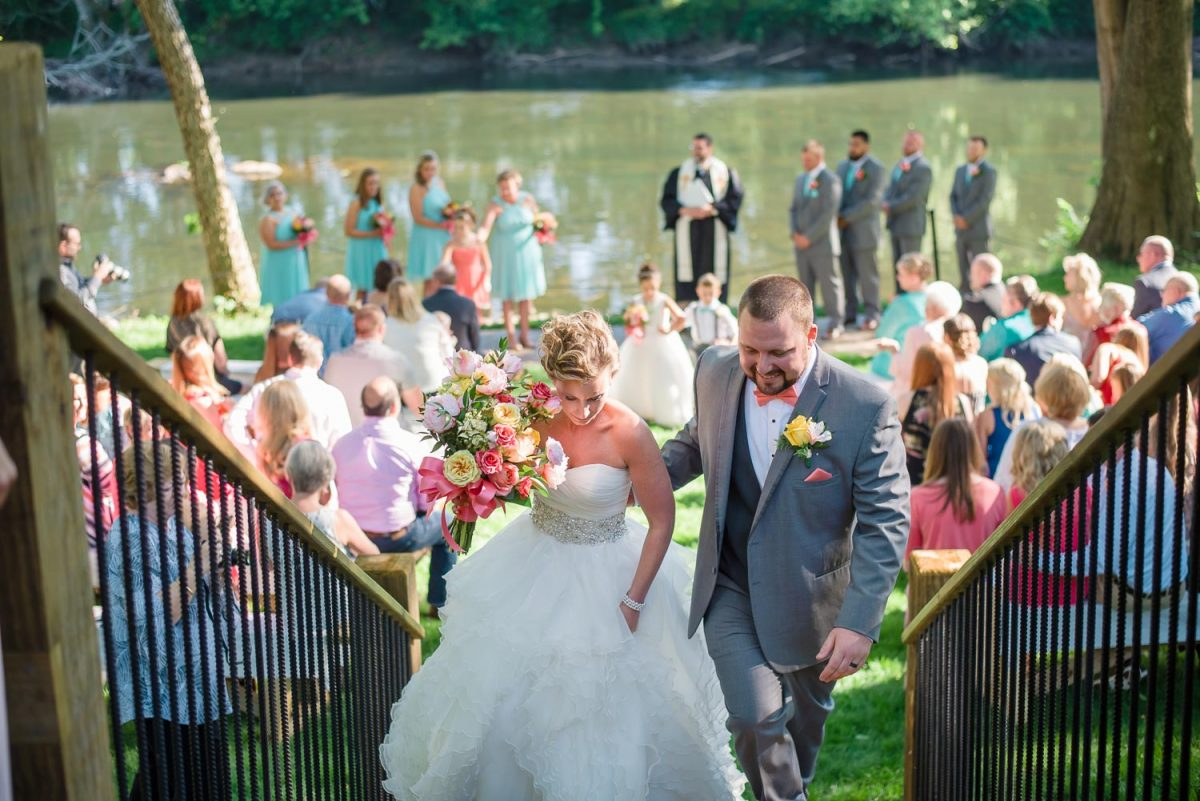 just married couple walks up stairs from ceremony on Hiwassee River in Delano TN