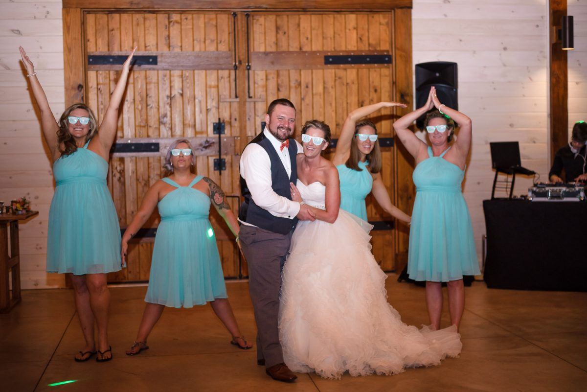 bridesmaids singing YMCA and bride with bride glasses on