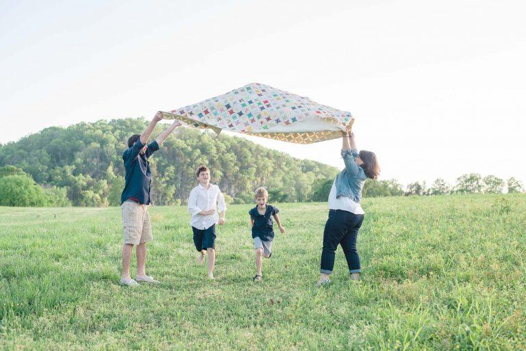 Kids running under quilt at the park