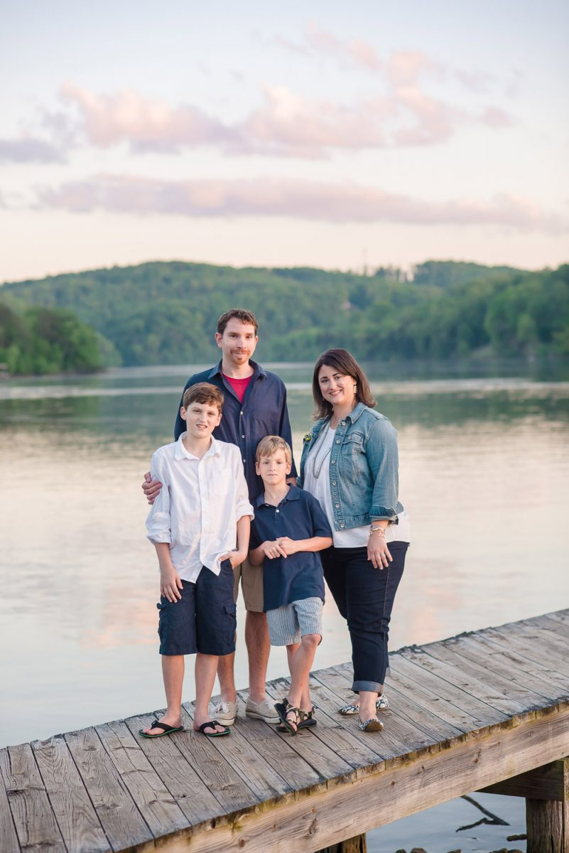 family of four on dock at sunset in Knoxville