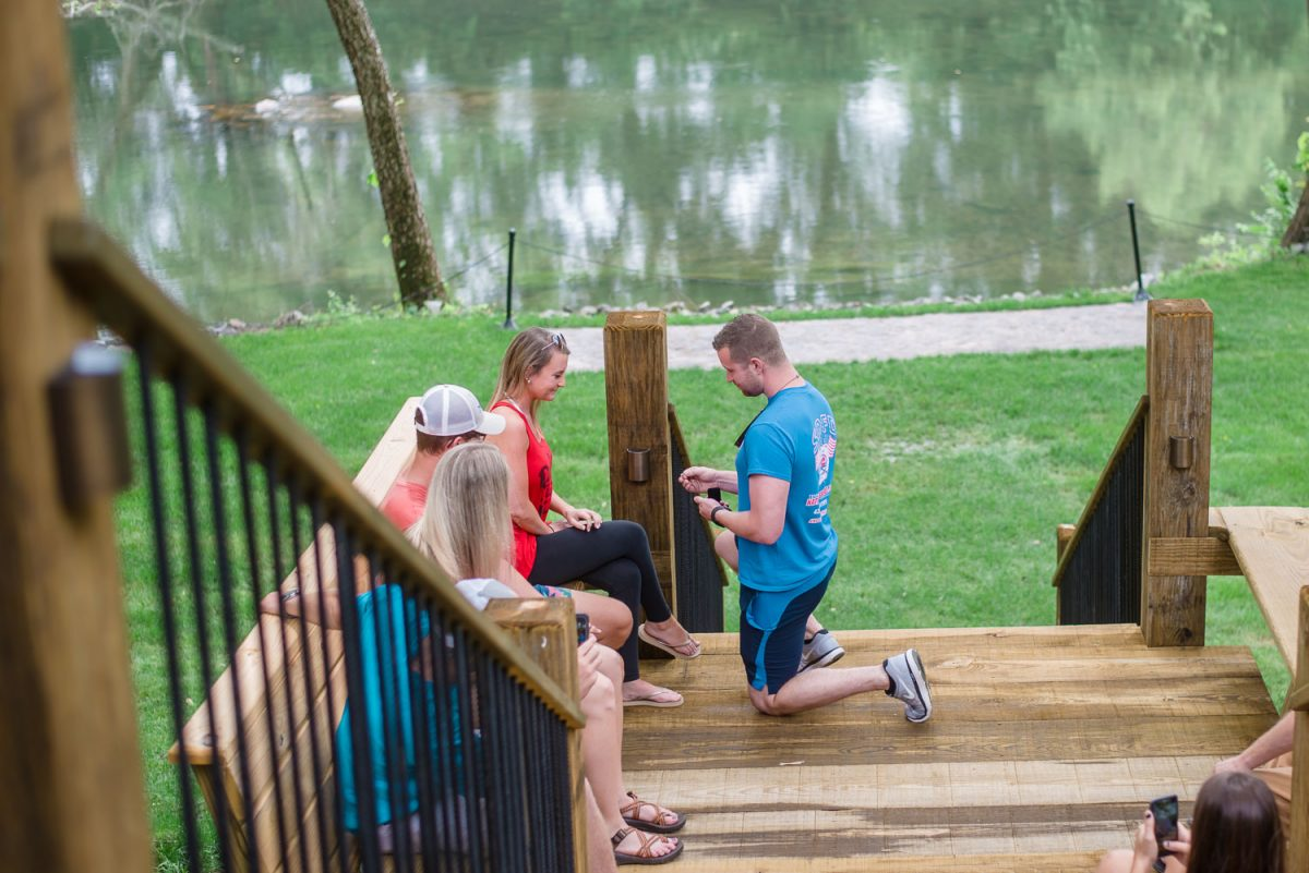 guy proposing to girlfriend at Hiwassee River Weddings