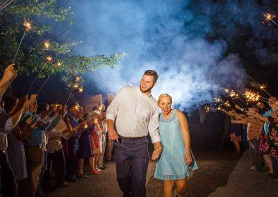 best sparkler wedding exit with bride in short blue lace dresse