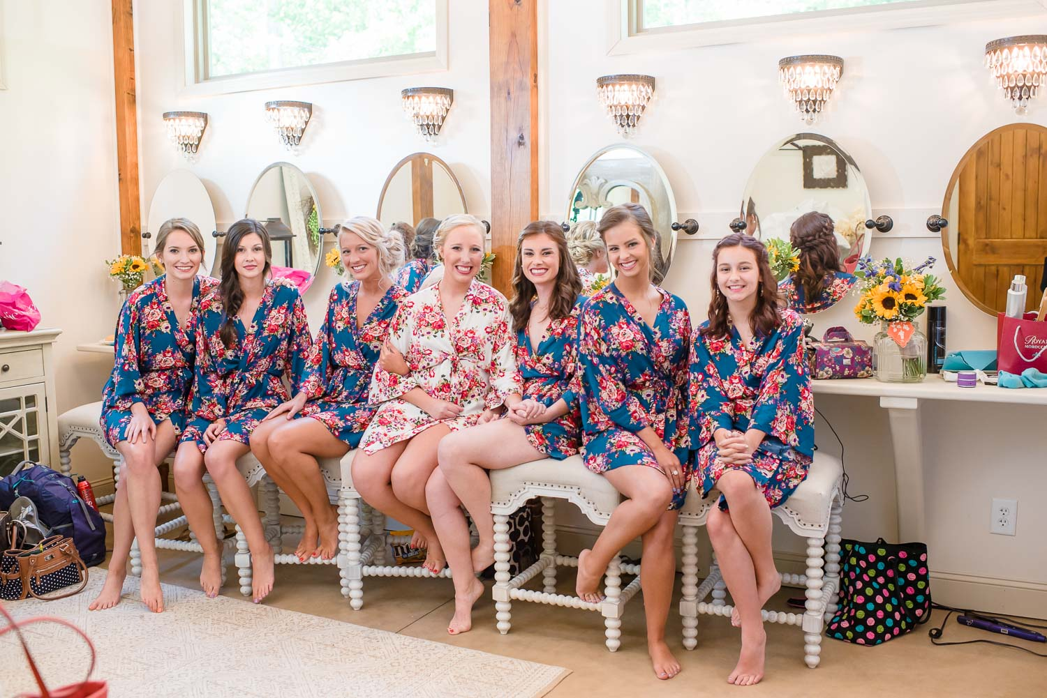 bridesmaids on white stools in bridal suite at Hiwassee River Weddings