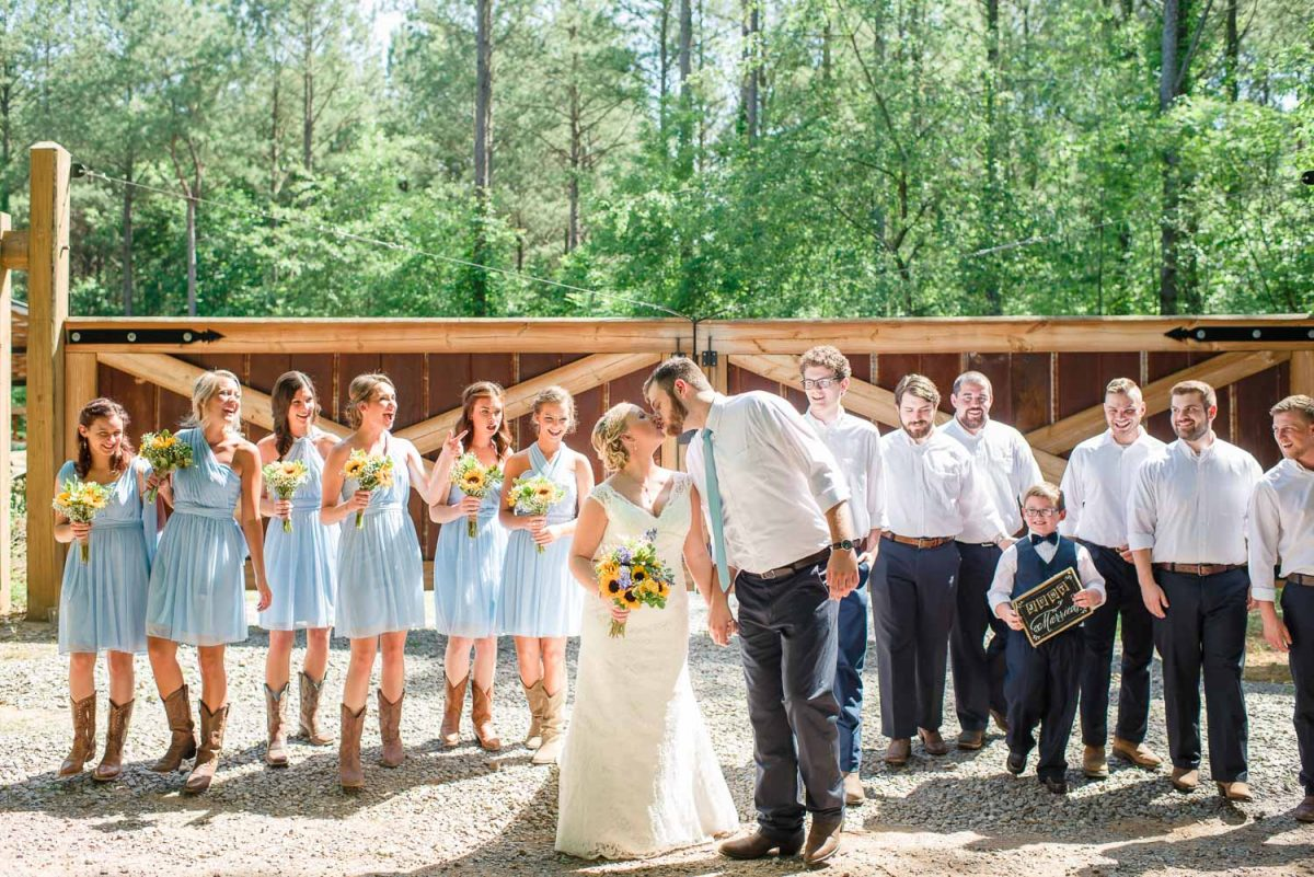 wedding party in front of sawmill shed gate at Hiwassee River weddings in TN