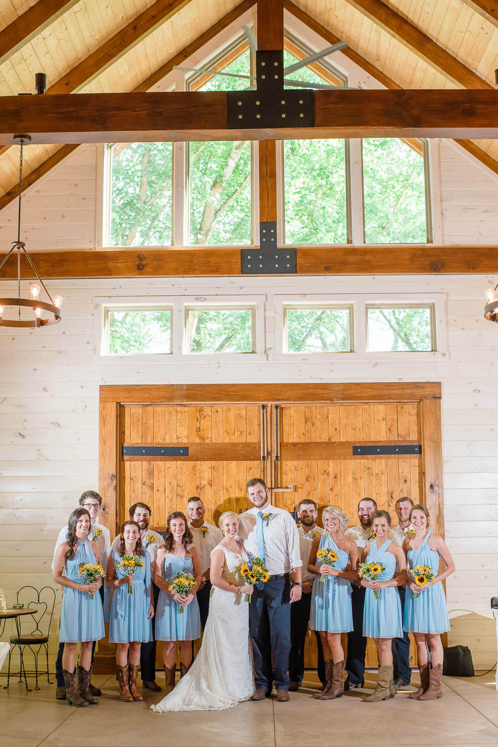 wedding party in front of big woden doors at Hiwassee River Weddings in Delano TN