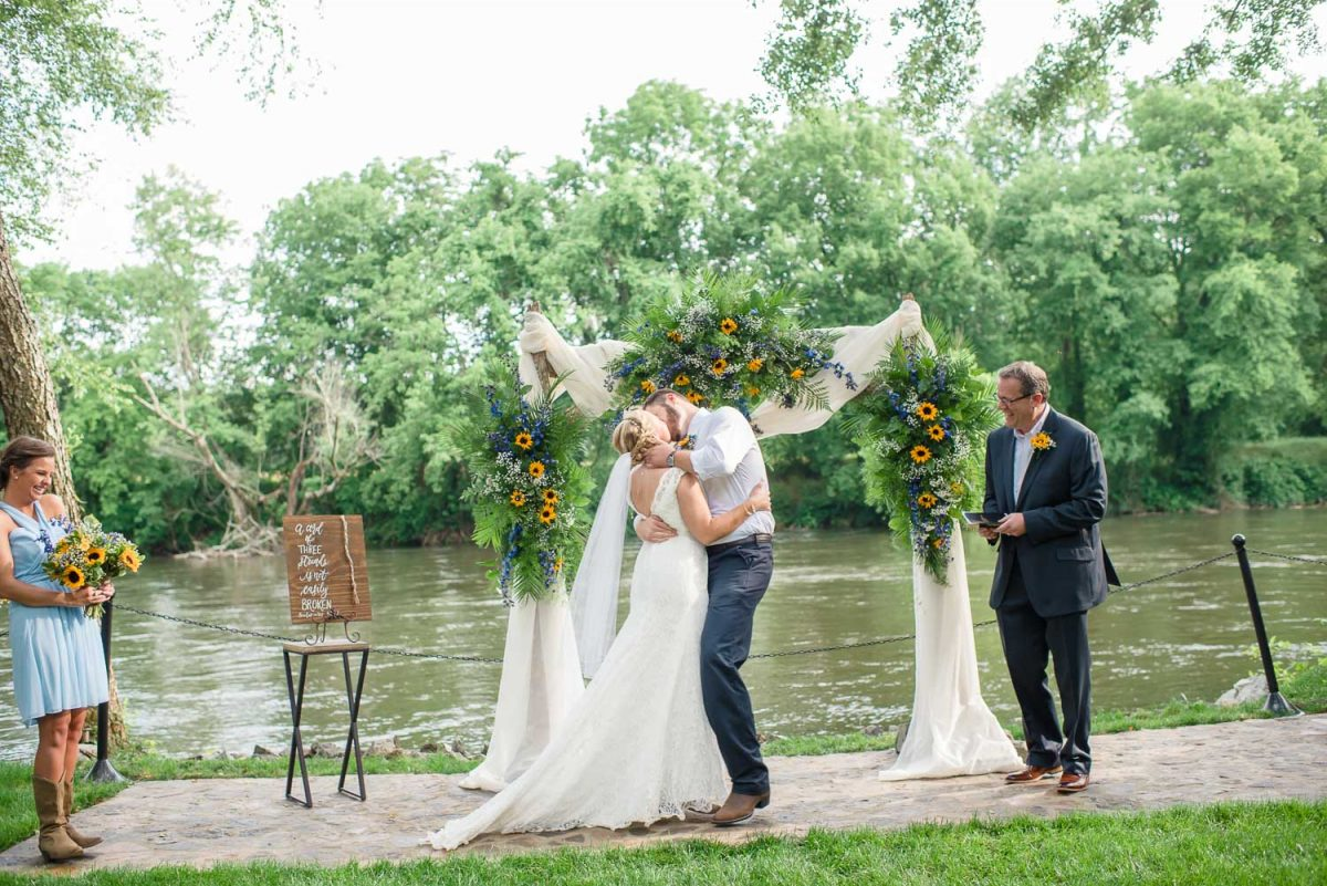 new mr and mrs first kiss at Hiwassee River weddings in TN