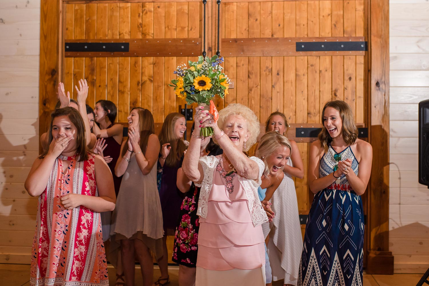 grandmother catching brides bouquet at Hiwassee River weddings