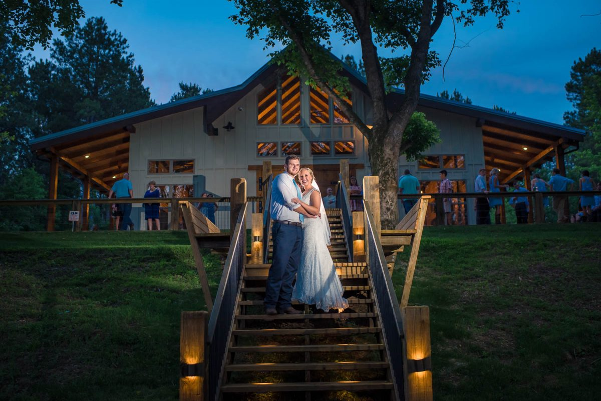 wedding photo on back patio at night on the Hiwassee River in TN