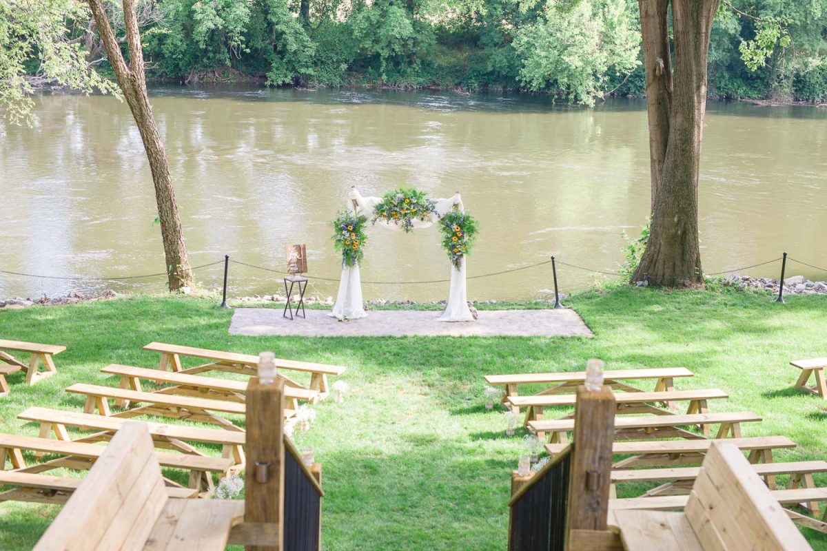 sunflower and greenery wedding arch on Hiwassee River