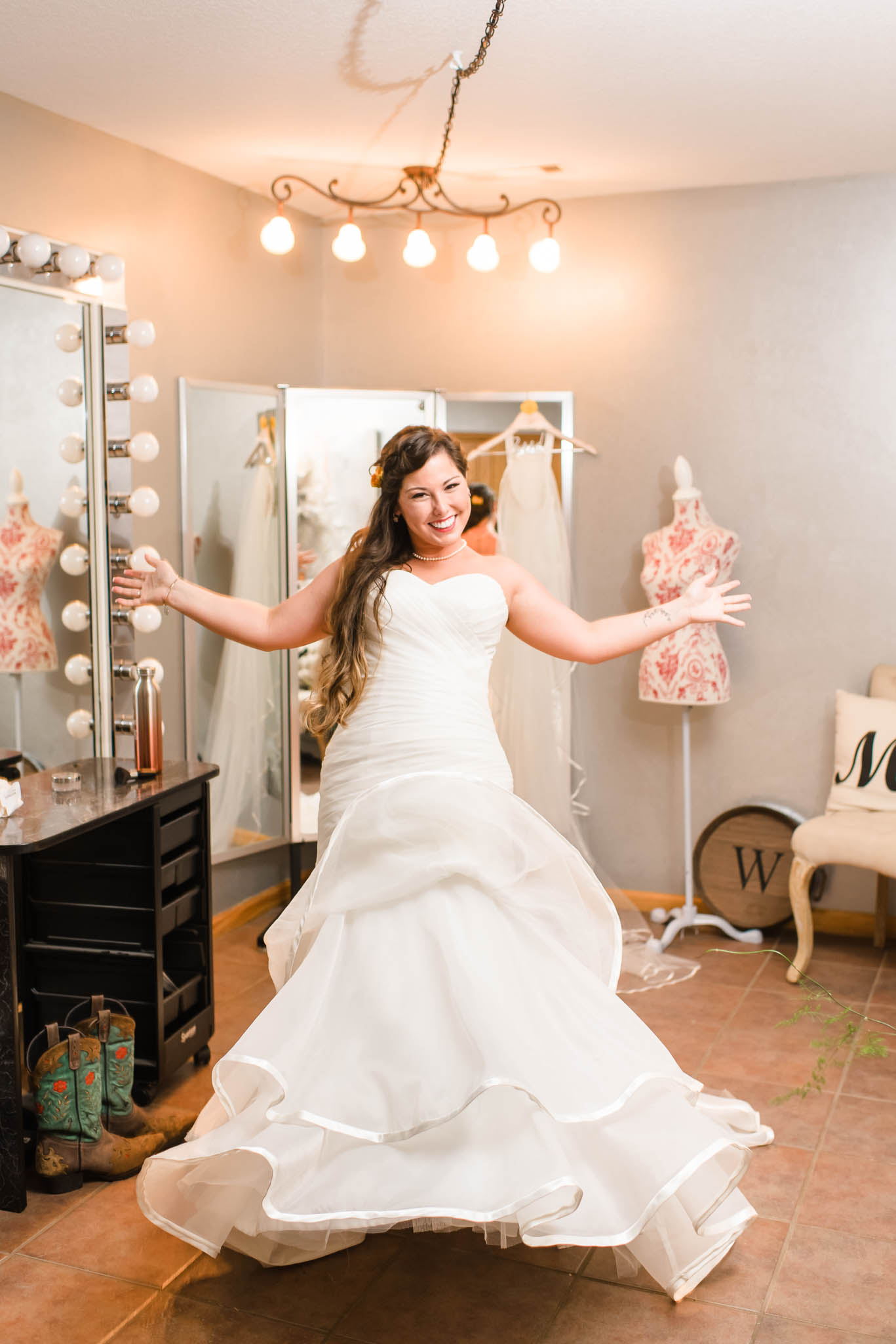 bride doing a little happy dance in her wedding dress