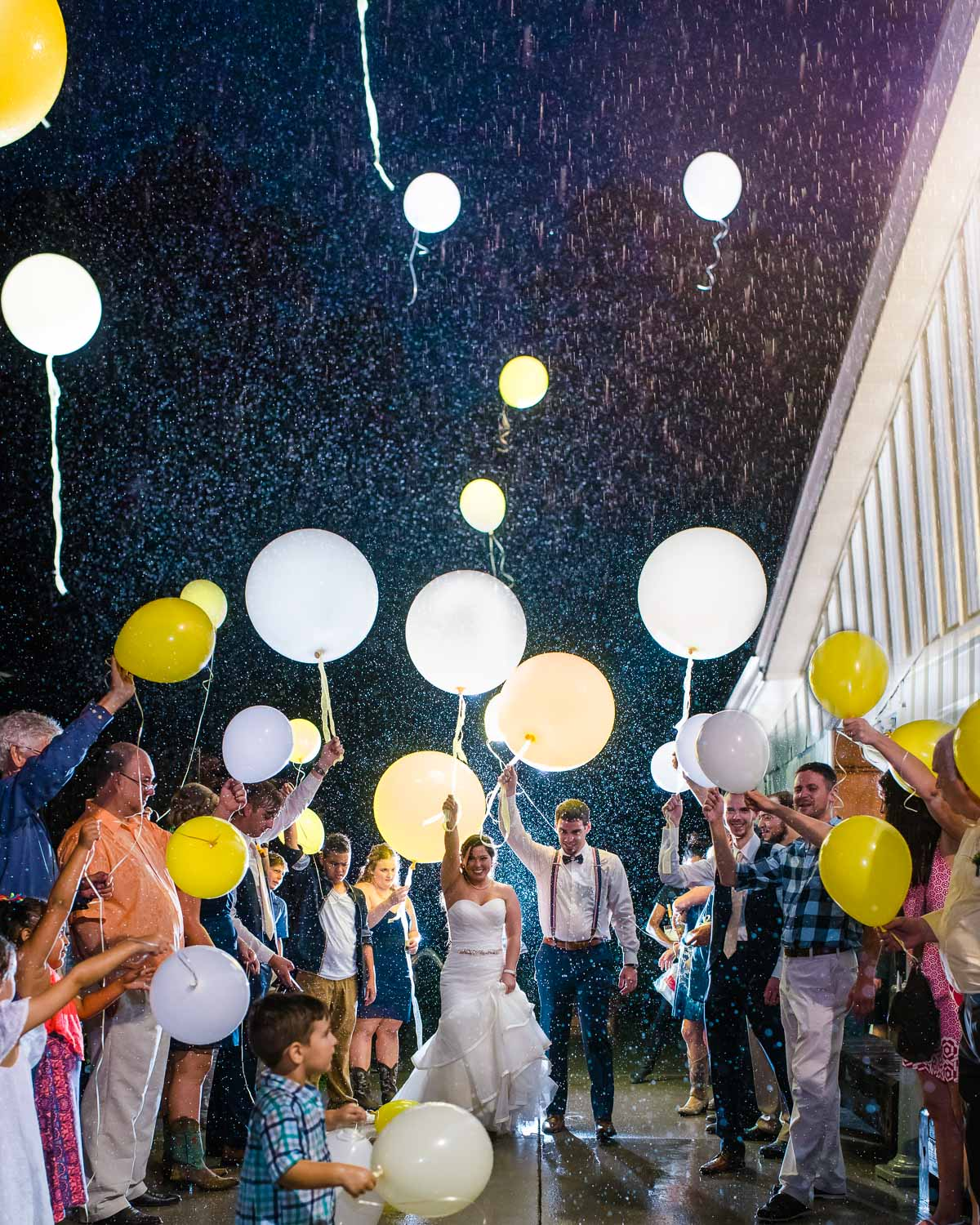 balloon wedding exit in the rain at night