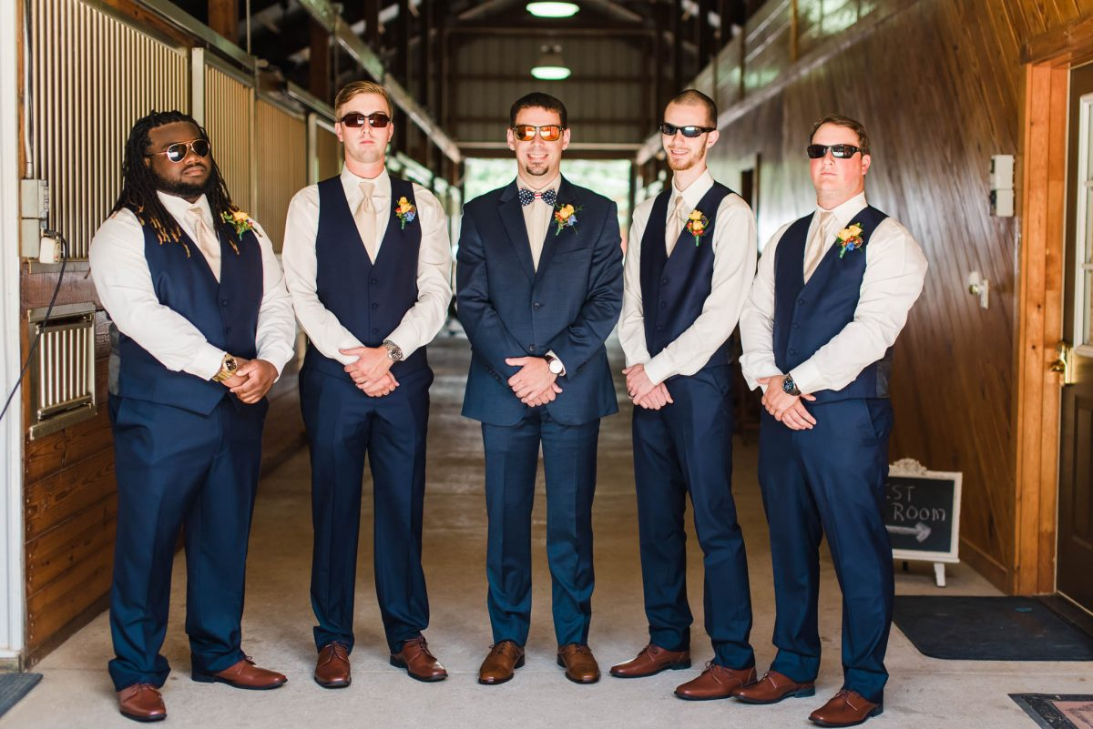 wedding party in sunglasses and navy vests in Knoxville TN