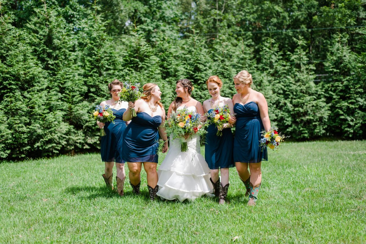 bridesmaids and bride in lower wedding ceremonyarea at sun dance farm in Knoxville