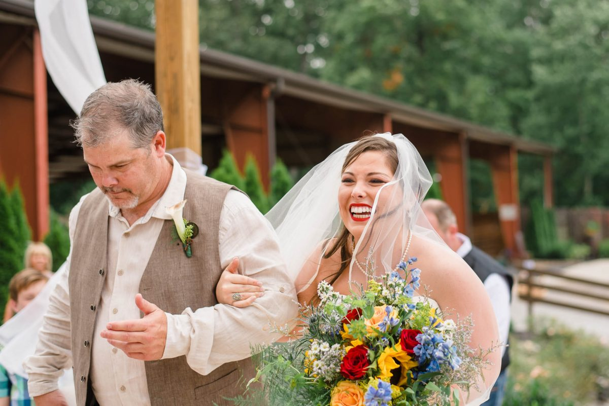 bride smiling her best smile as she sees her groom