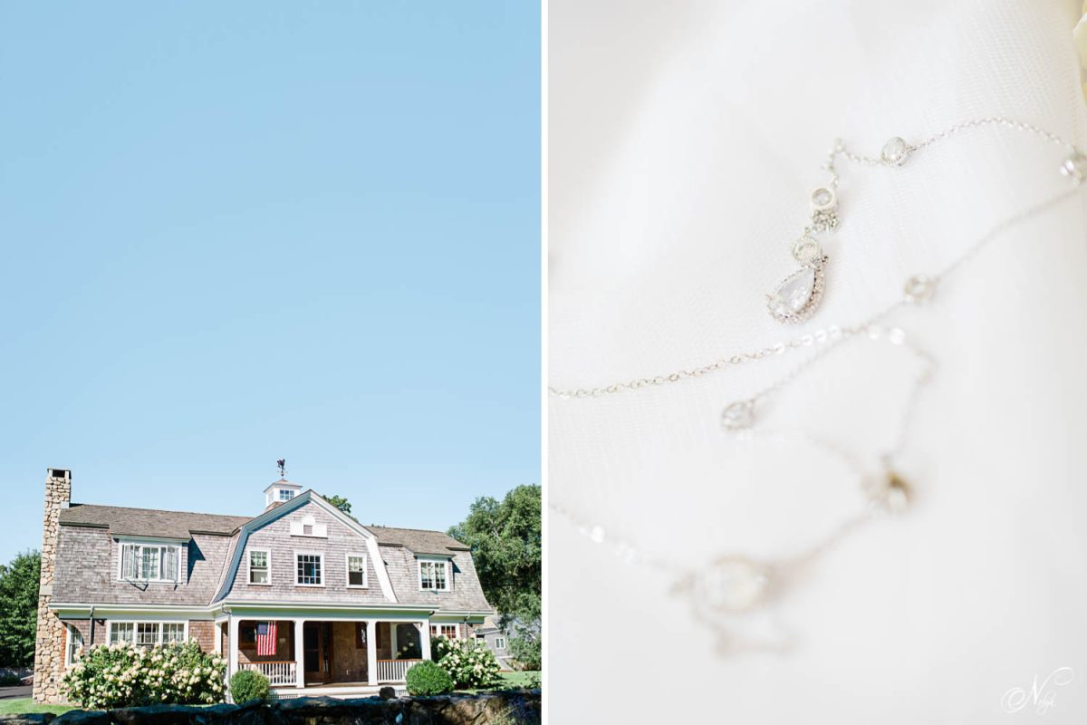 cape cod house and brides necklace laying on her wedding dress