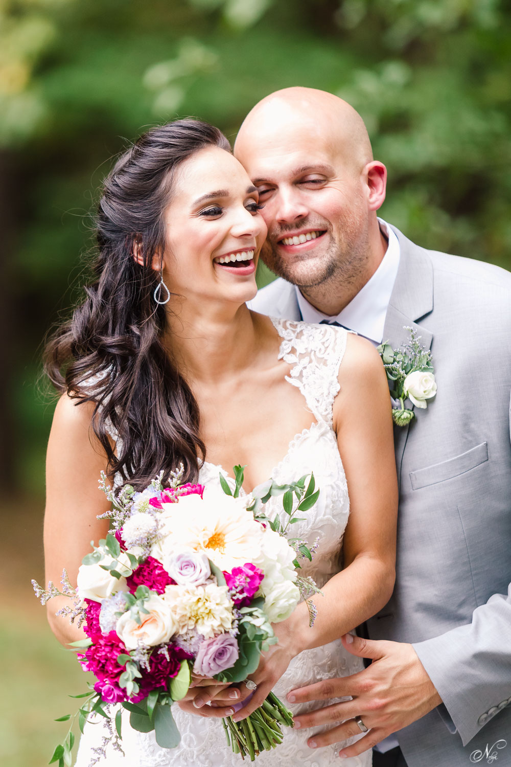 bride laughing with her husband under the pines in TN