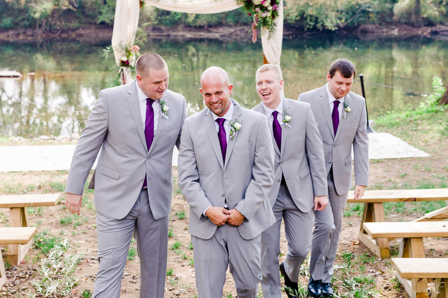 just the guys walking towards the wedding venue before the ceremony