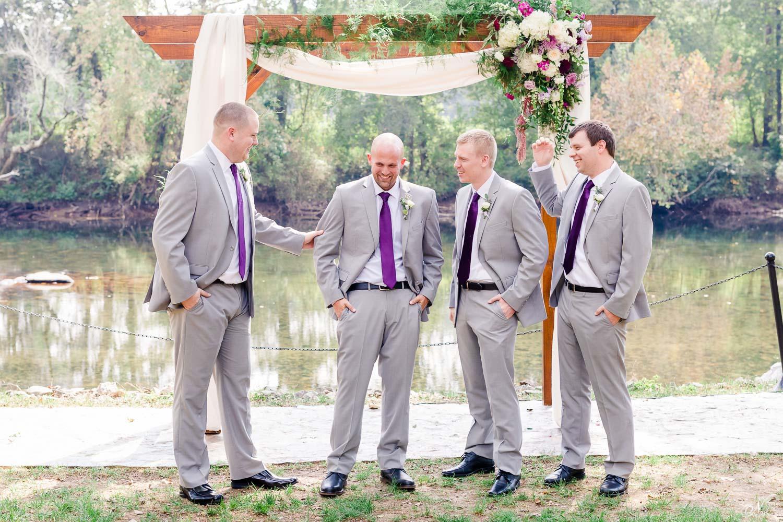 groomsmen and groom jokingaround on the hiwassee river in DelanoTN
