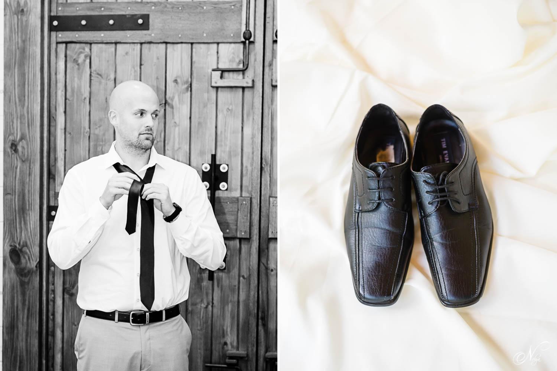 groom tieing his tieand grooms shoe details