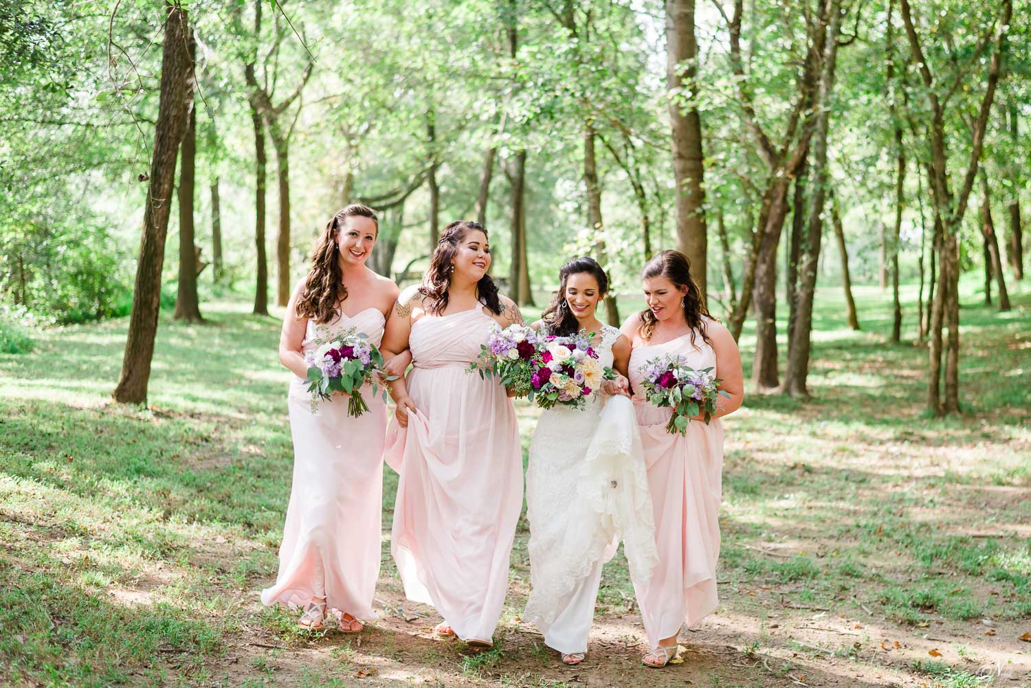 just the girls walking in the sunlit trees together at the Hiwassee riverside wedding