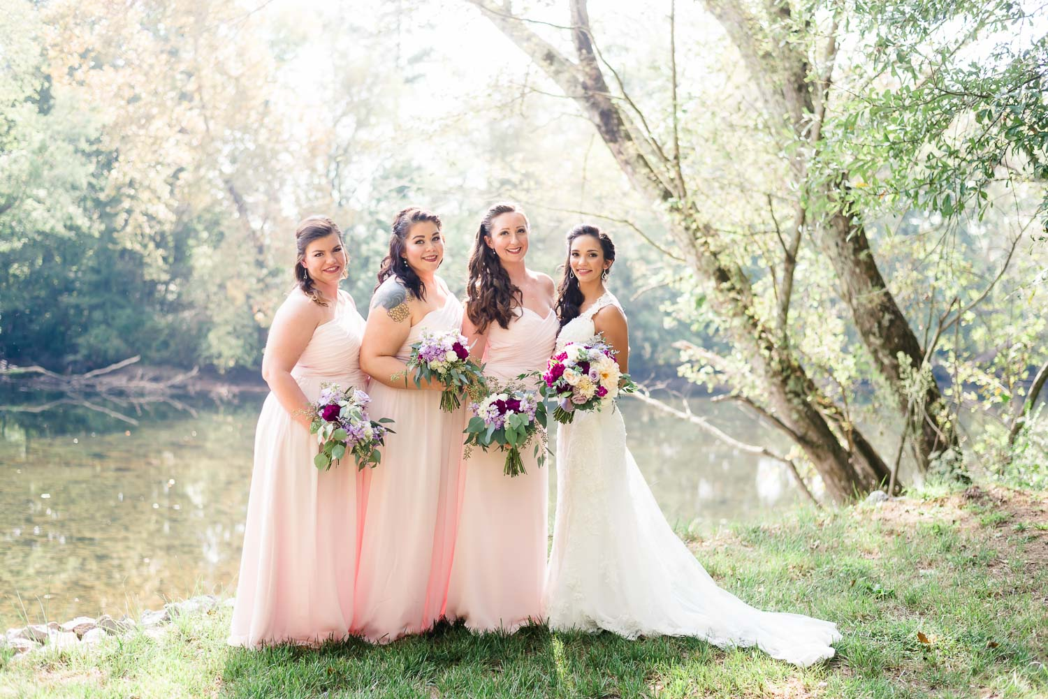 bridesmaids standing on dege of hiwassee river in Delano TN