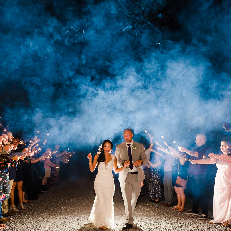 smoky sparkler wedding exit backlit with an off camera flash