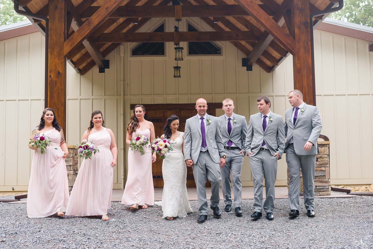 bridal party in pale pink and gray with purple ties