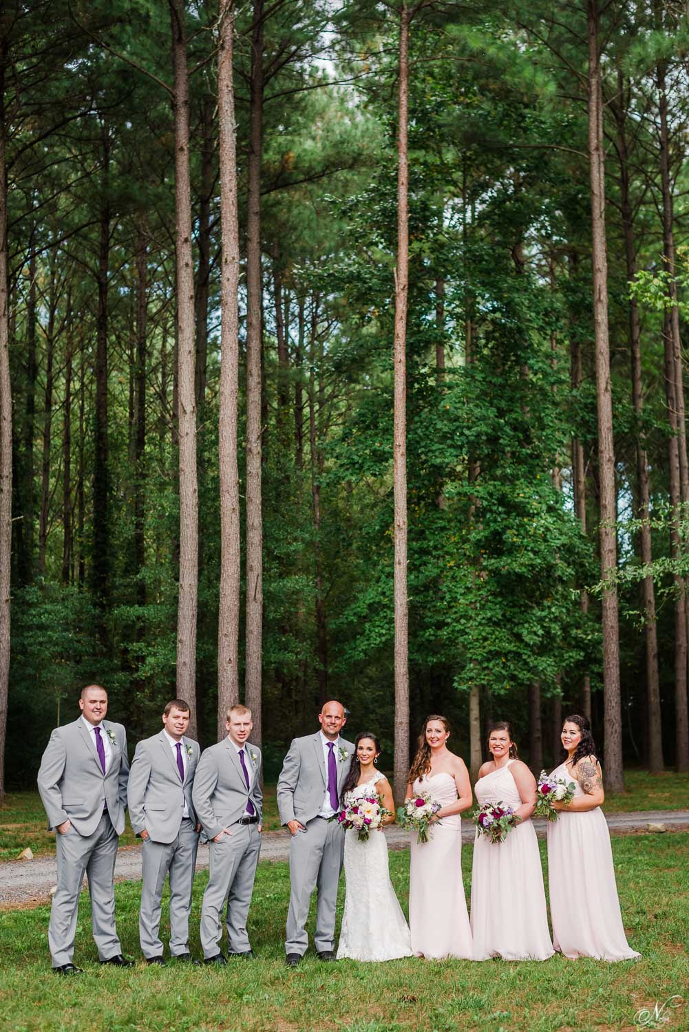 forest wedding party photos with pine tree backdrop