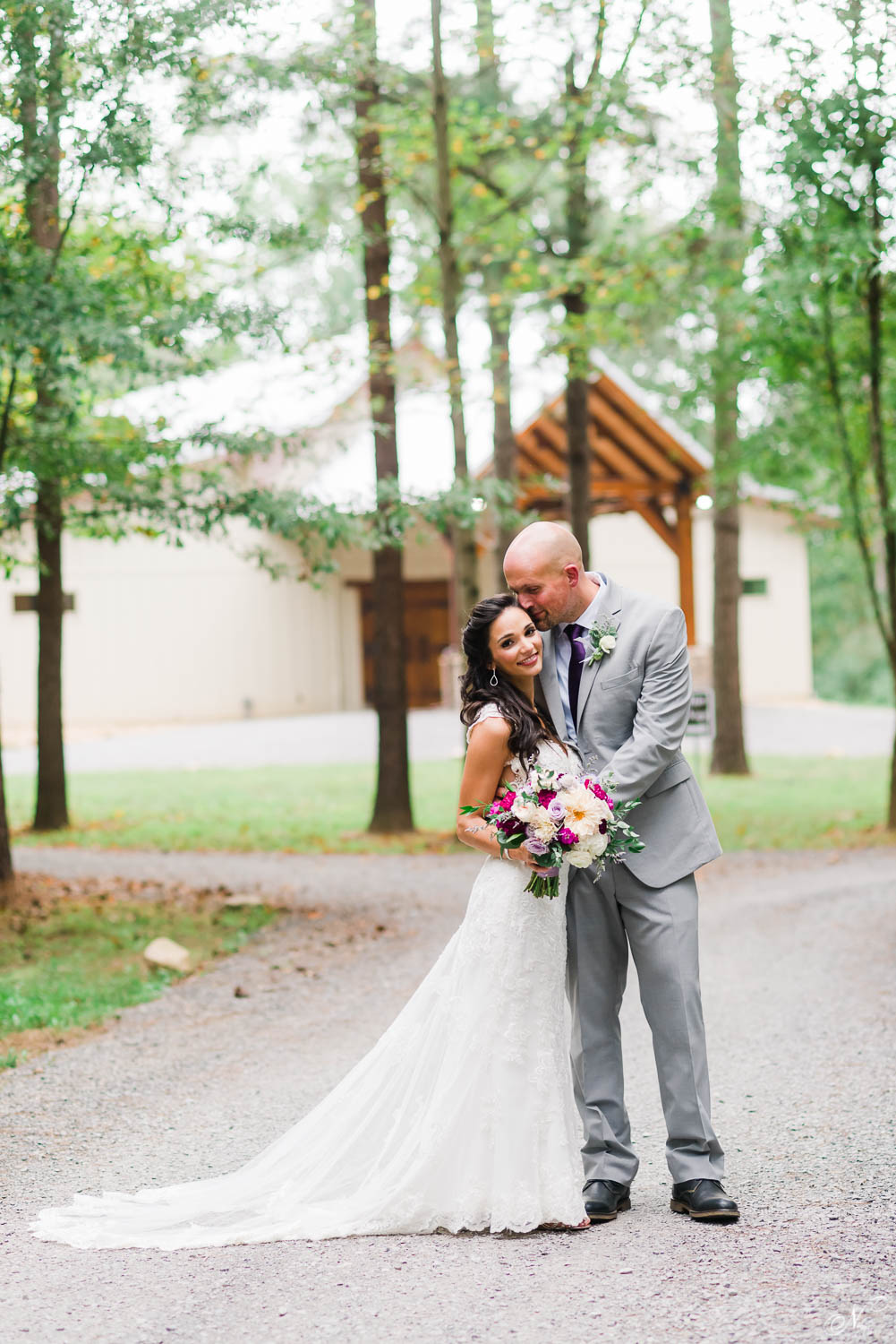 wedding photo of bride and groom in front of portico at Hiwassee River Weddings
