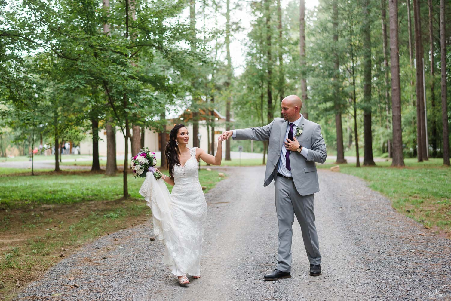 bride and groom dancing onwindy road to Timber framed wedding venue in Delano TN