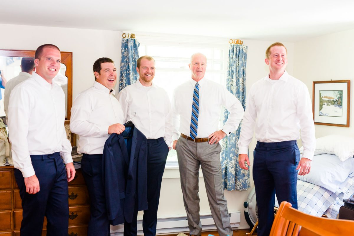 groomsmen looking at groom and smiling