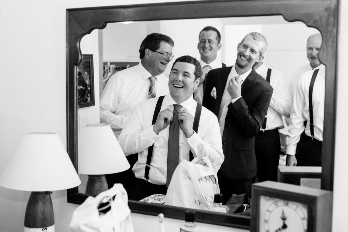 groom and his guys looking in mirror