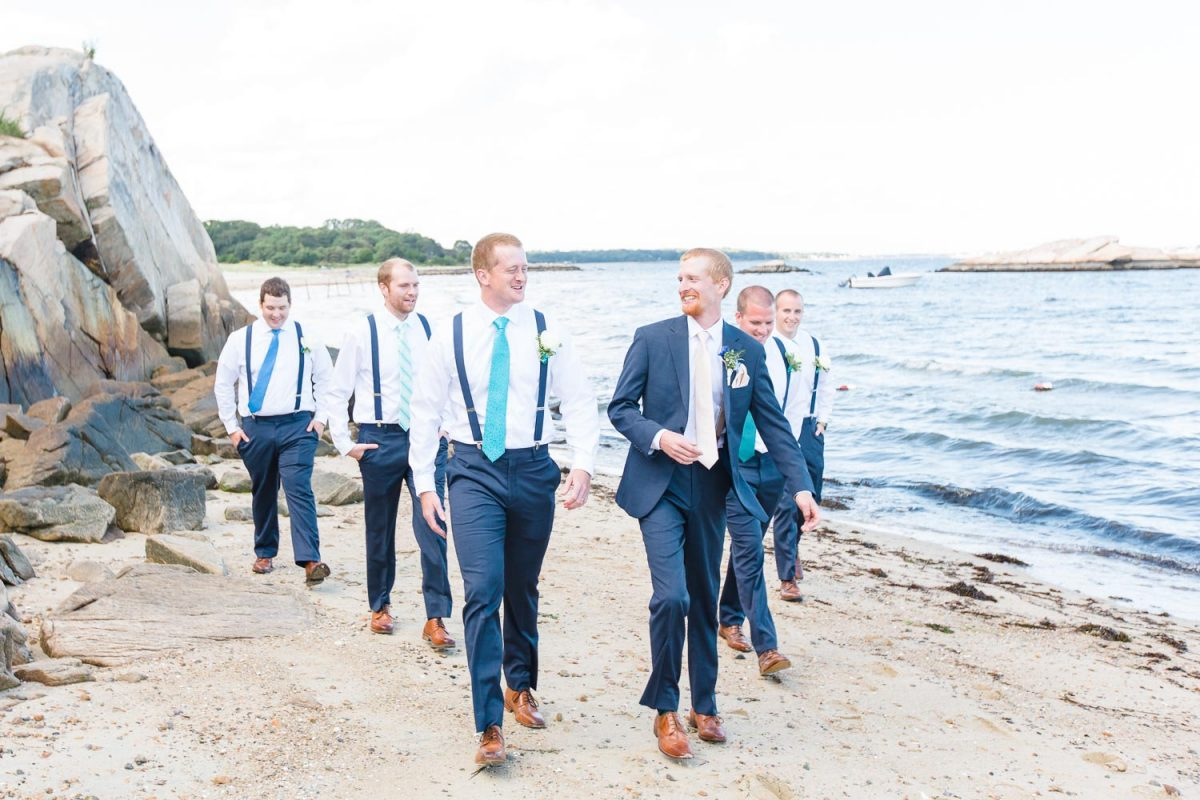 groomsmen in navy pants and white shirts
