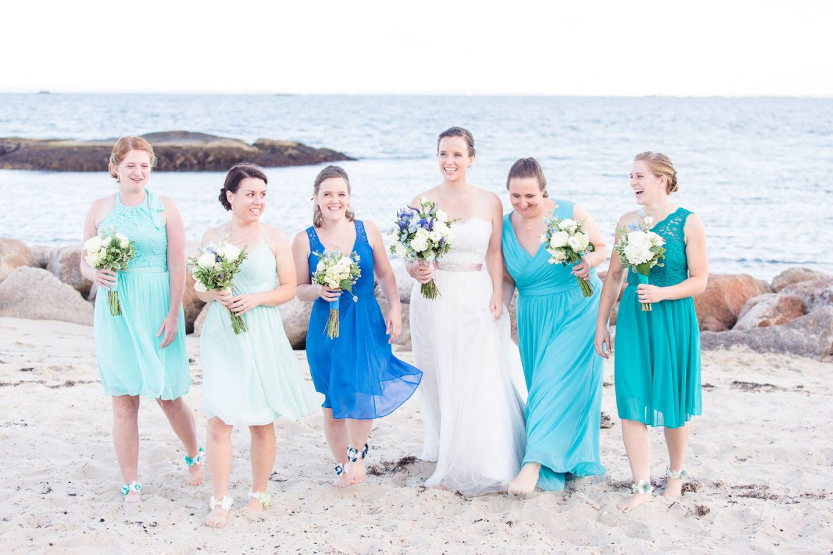barefoot bridesmaids with ankle flowers in shades of blue
