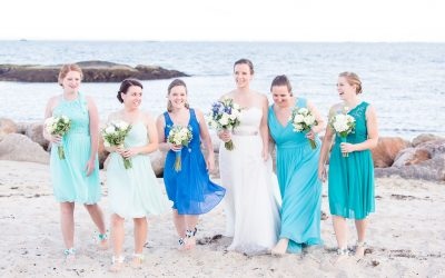 Girls walking on beach in teal, blue and turquoise bridesmaids dresses