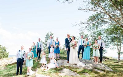 wedding party photos staggard on new England rock out croppings in September
