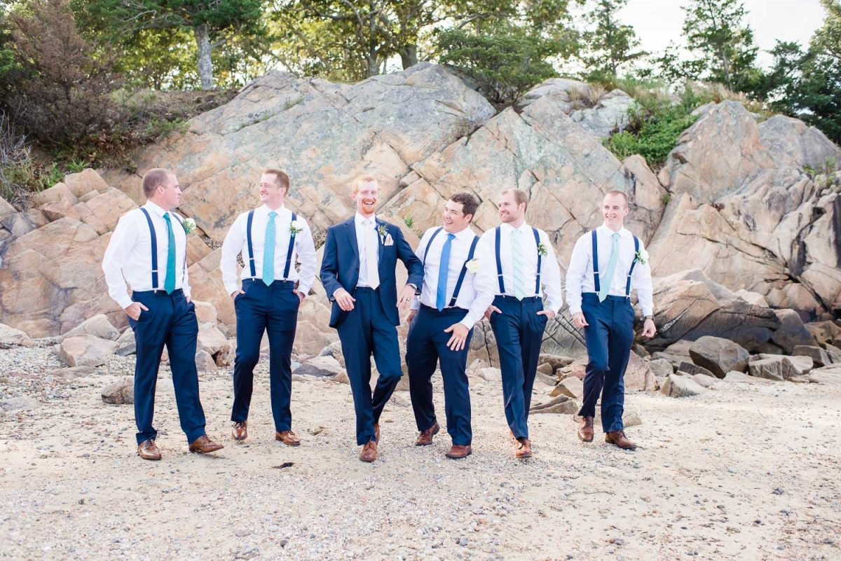 groomsmen with ties in shades ofaqua, turquoise, and blue