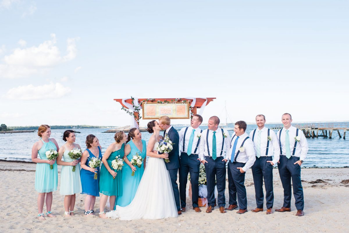 aqua turquoise tiffany blue and navy wedding party in front of homemede wedding arch