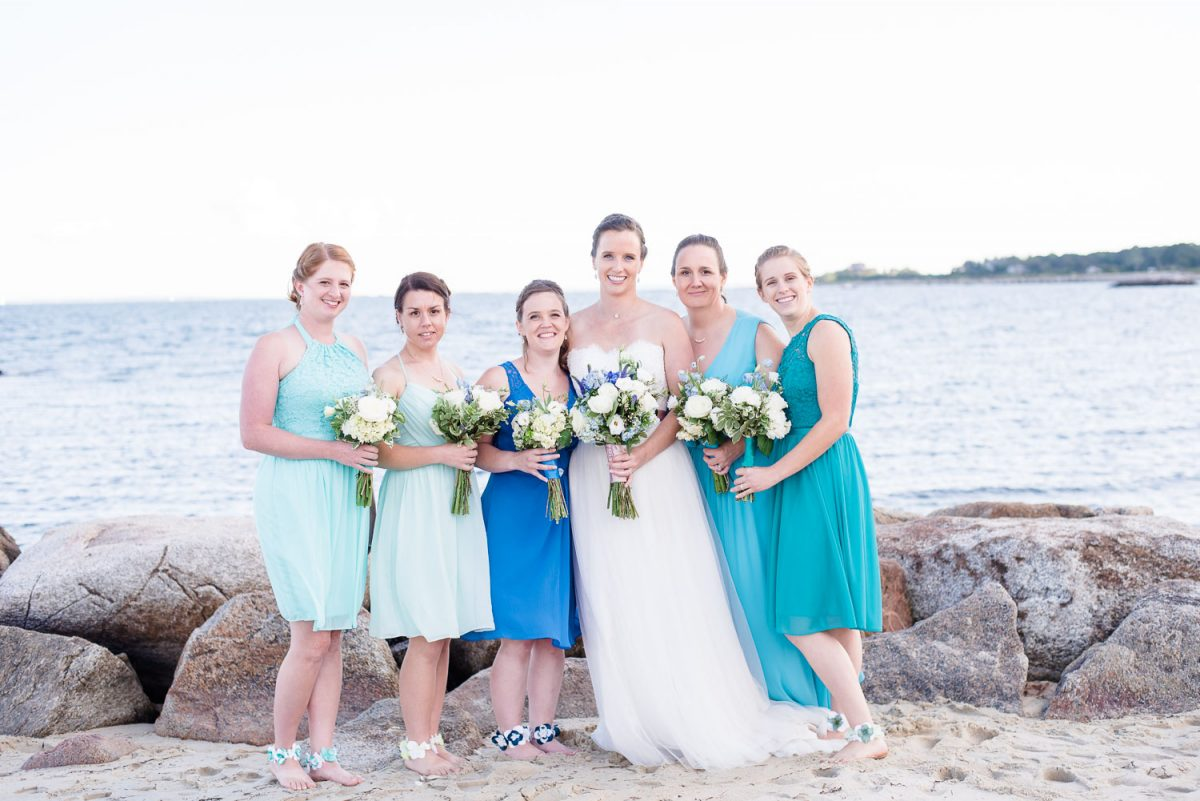 bridesmaids dresses in shades of aqua, turquoise and blue