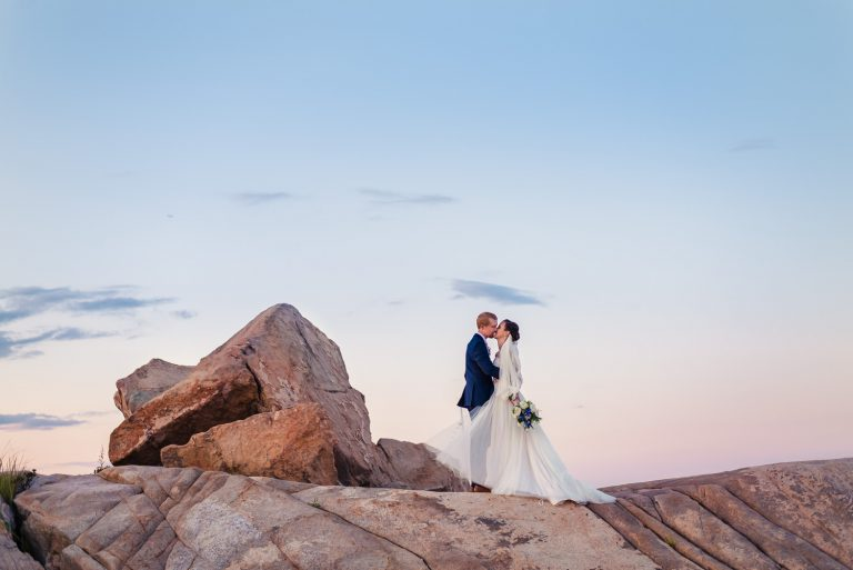 Massachusetts bride and groom sunset photos on pink rocks