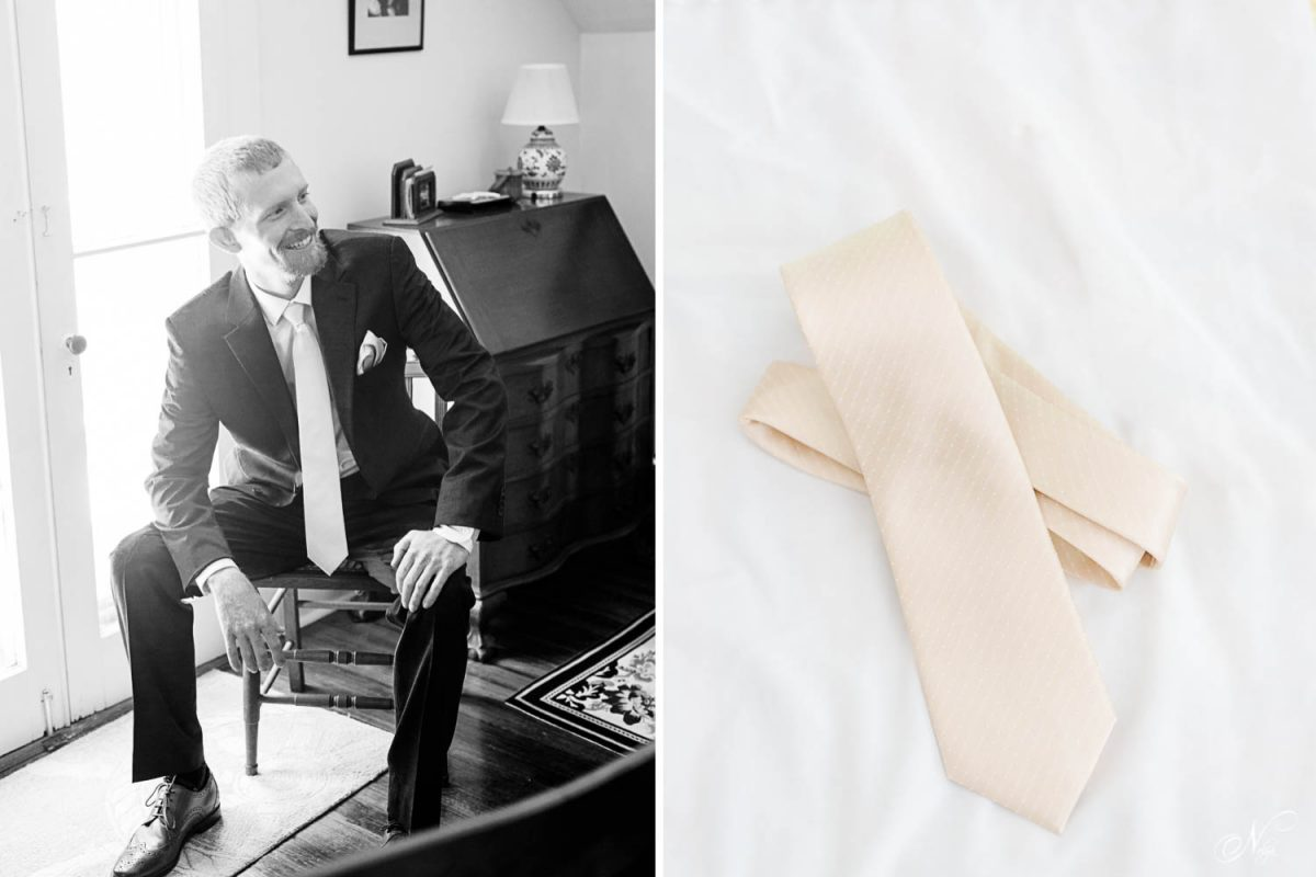 groom sitting by window and cream colored neck tie