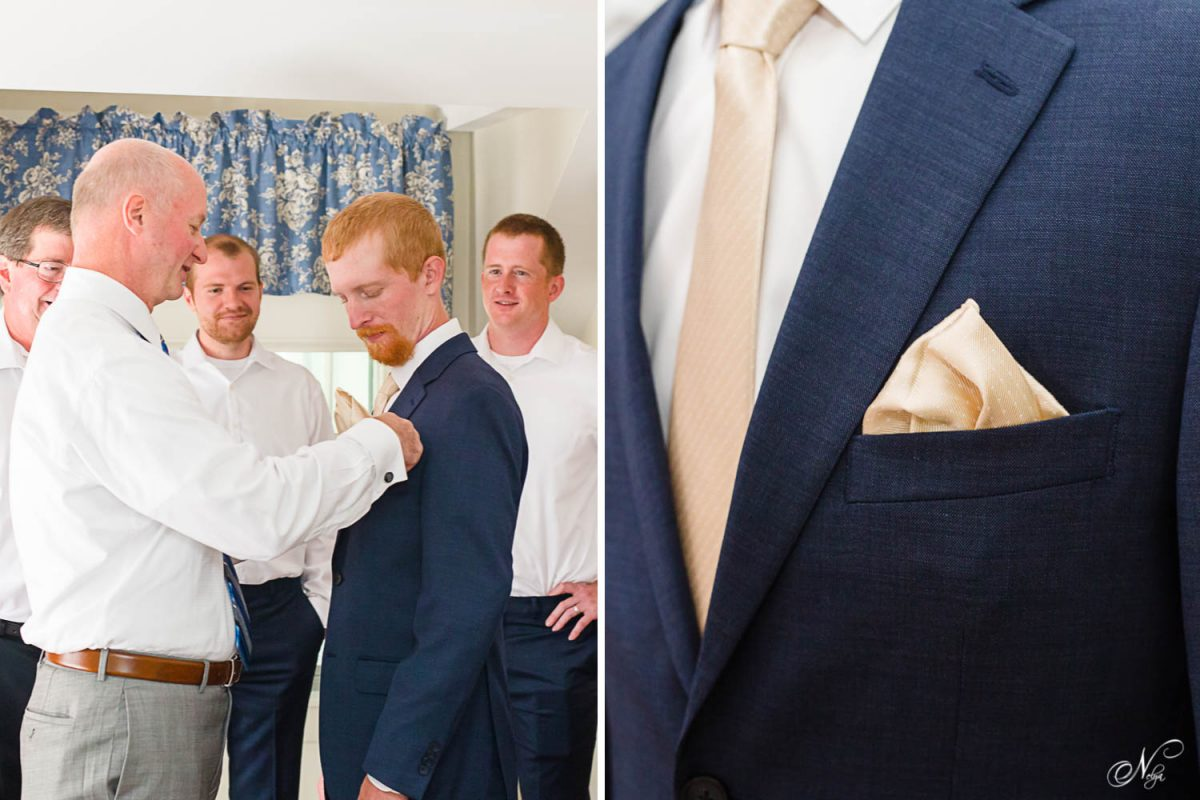 dad helping fold pocket square for groom