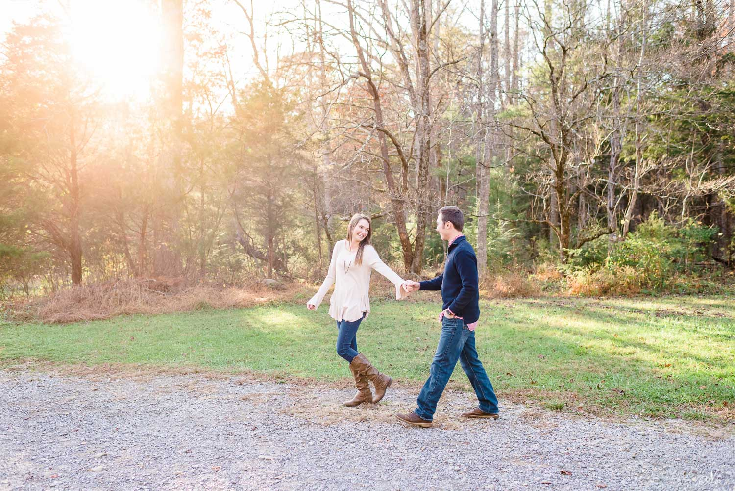 engagement photos walking in front of John Oliver Cabin in Townsend TN